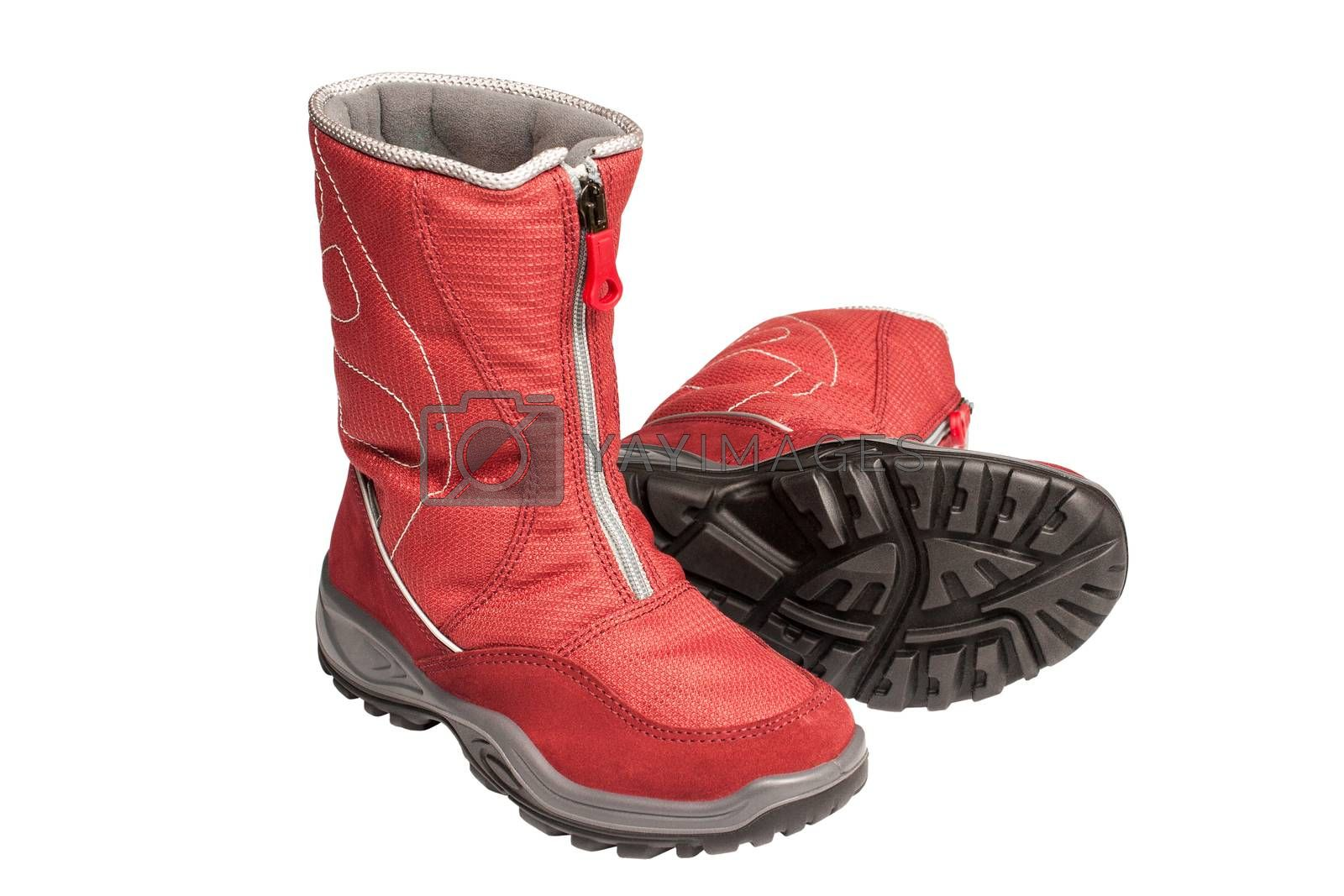 two children's red waterproof boots on a white background