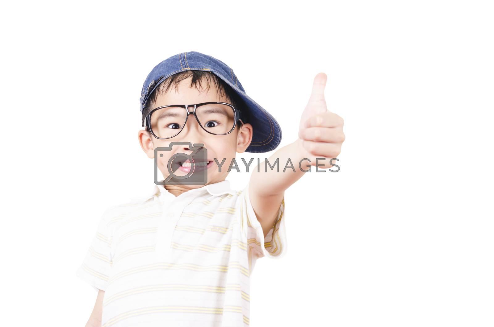 Royalty free image of Joyful little boy holding his thumb up by FrankyLiu