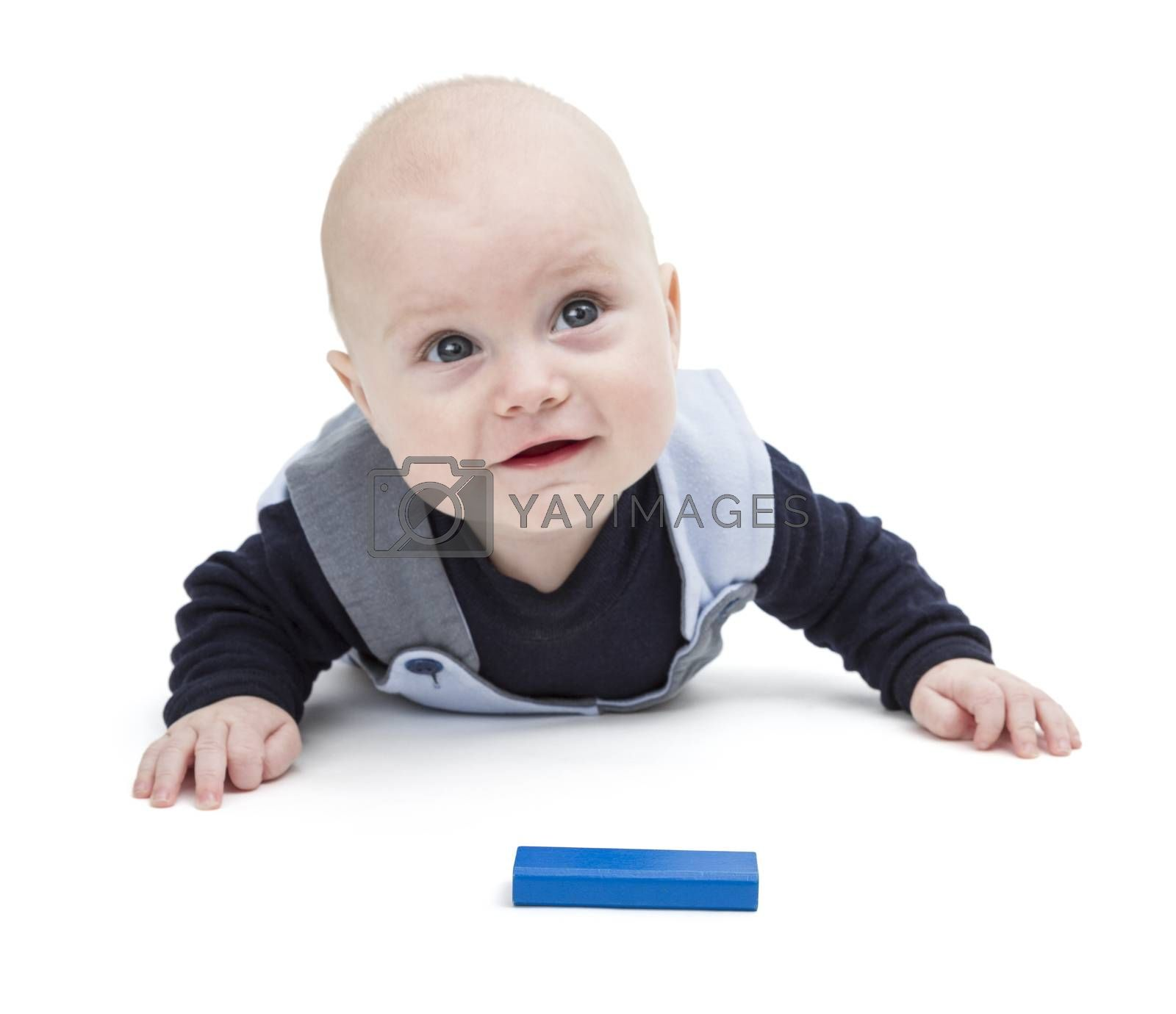 Royalty free image of interested baby with toy block by gewoldi