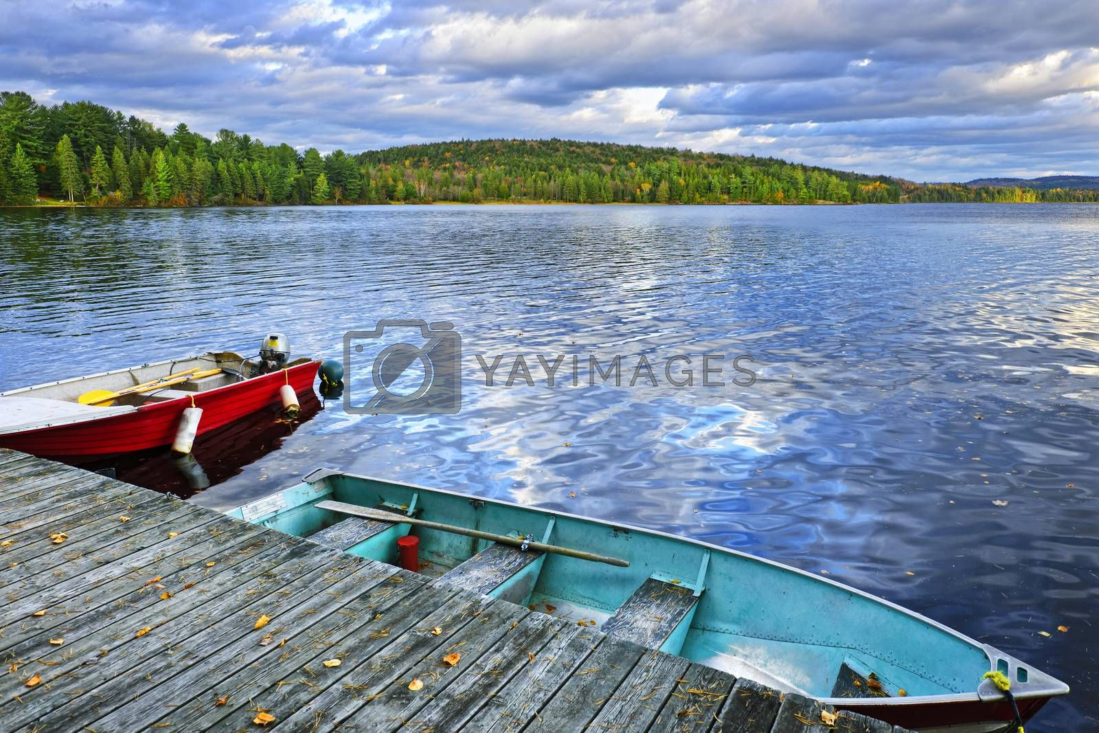 Rowboats docked on Lake of Two Rivers in Algonquin Park, Ontario, Canada