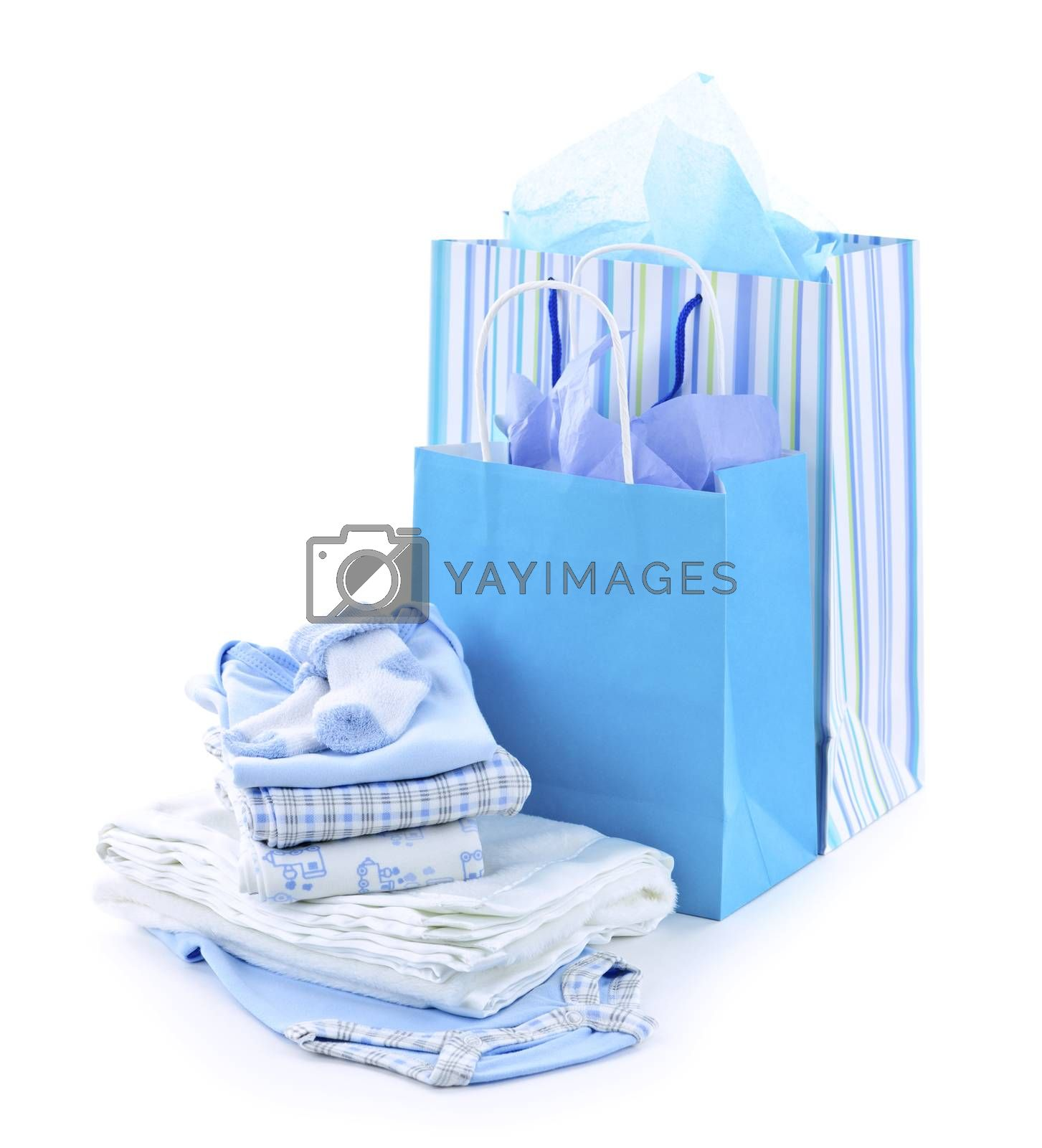 Gift bags and infant clothes for baby shower isolated on white