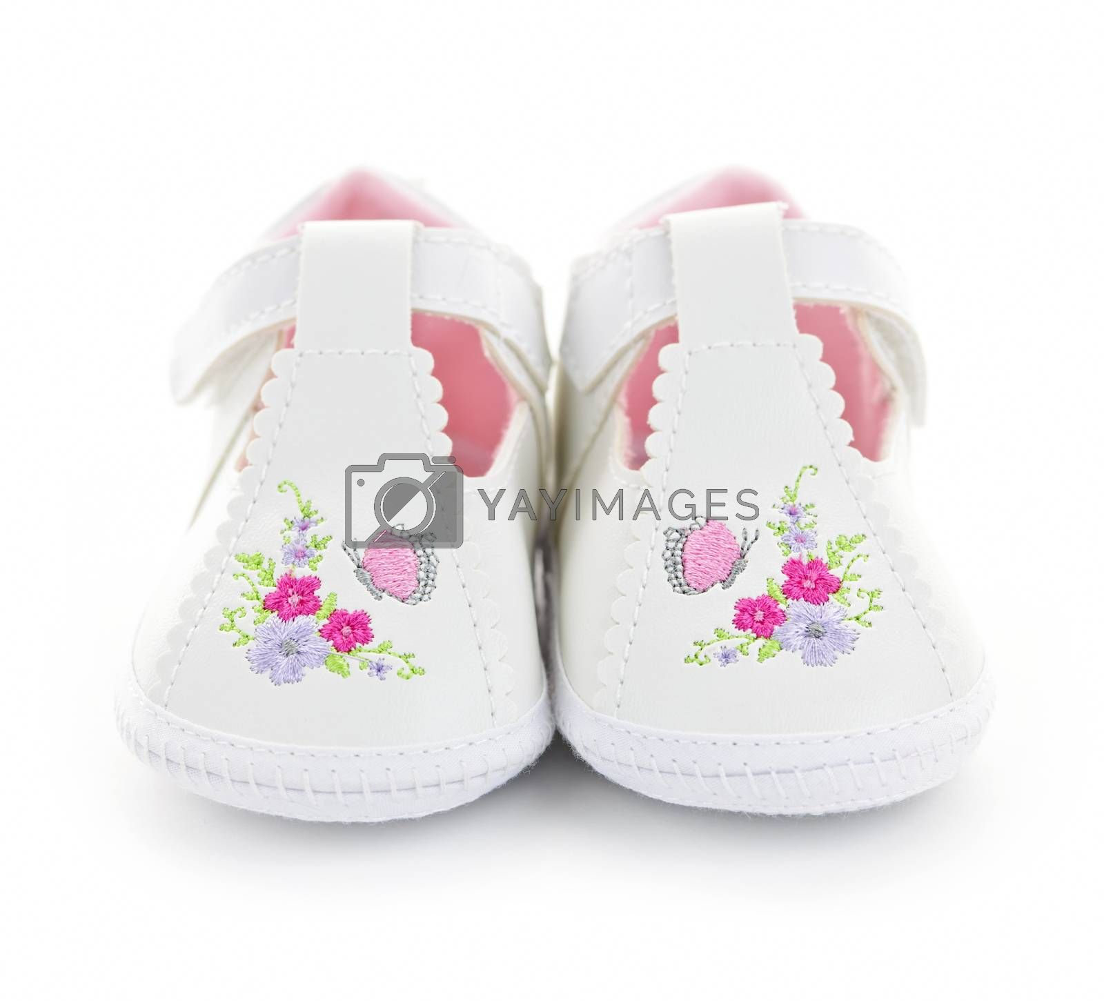 Closeup of girl baby shoes isolated on white background