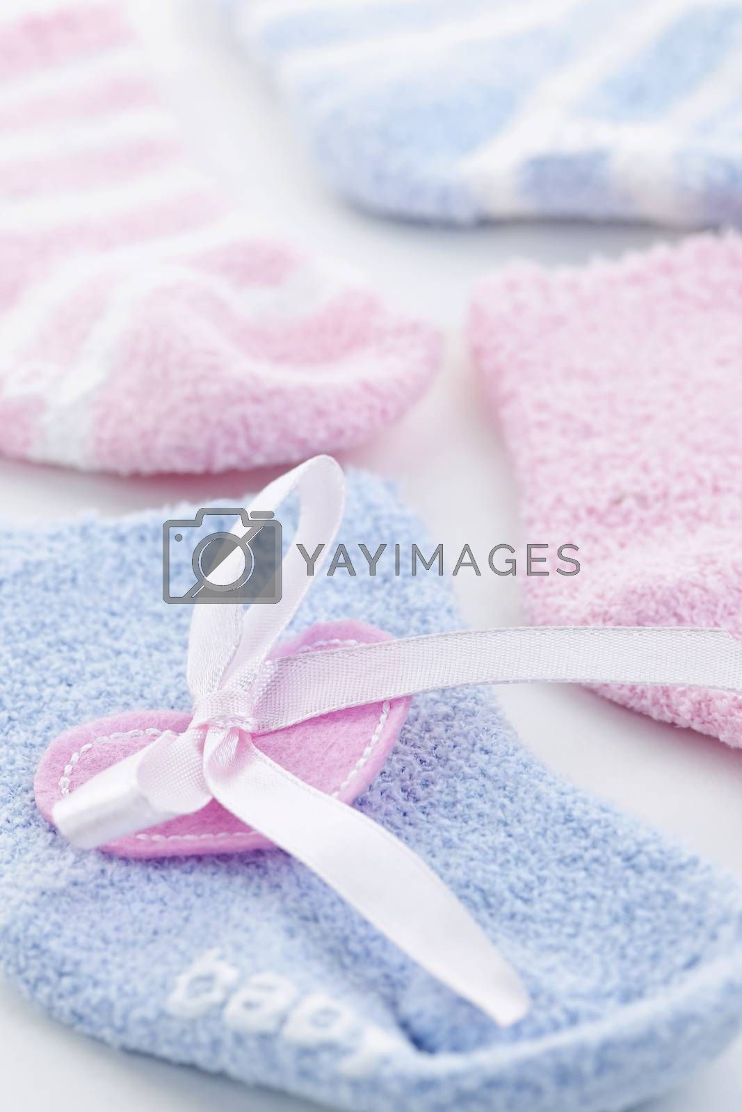 Pink and blue infant socks for baby shower with ribbon