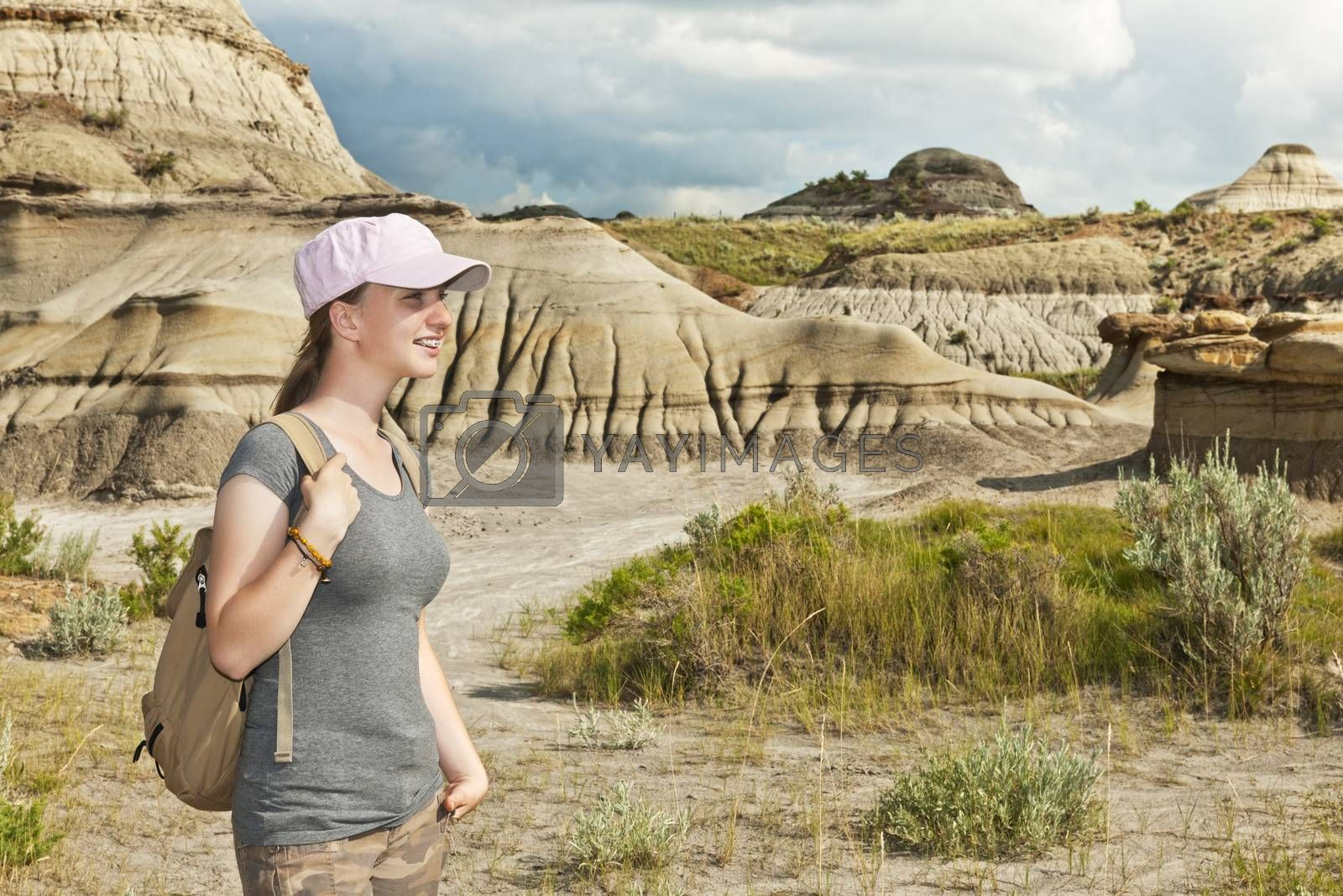 Girl enjoying scenic view at the Badlands in Dinosaur provincial park, Alberta, Canada