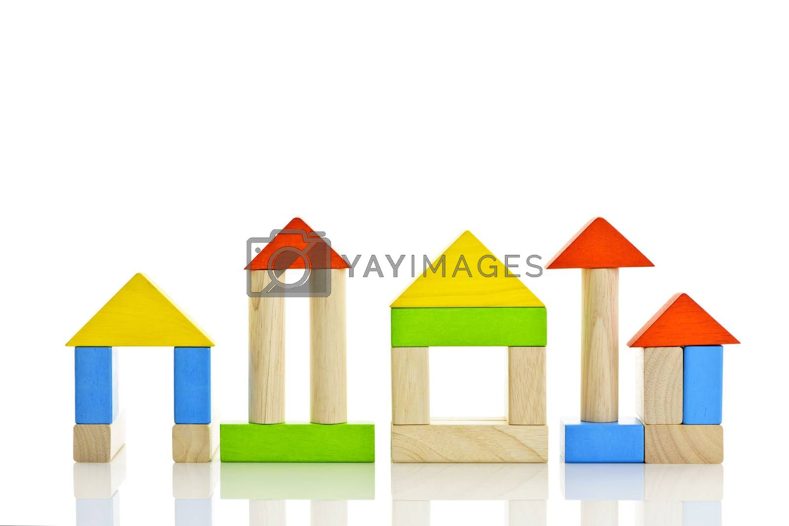 Buildings constructed out of toy wooden building blocks