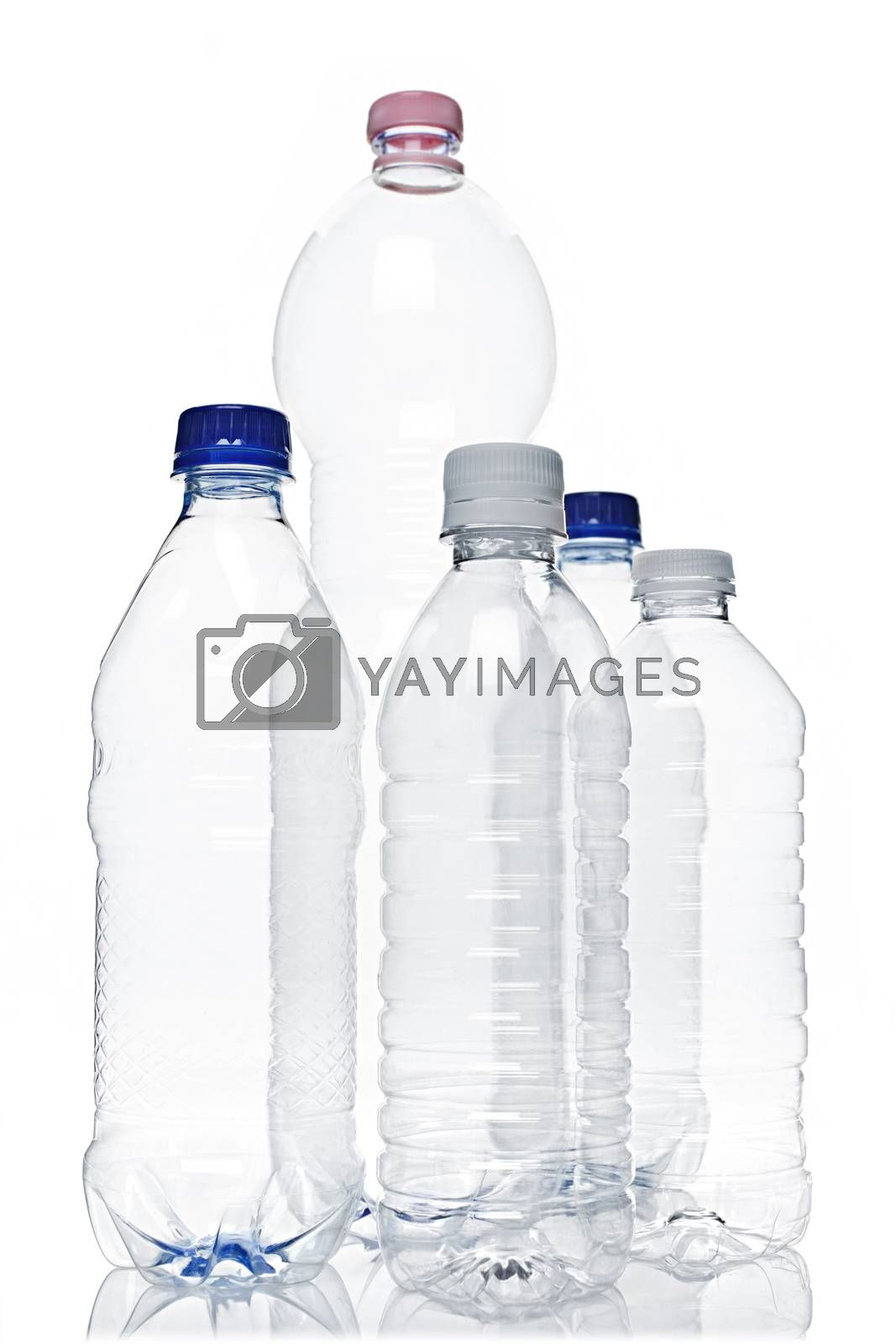 Assorted clear empty plastic recyclable bottles isolated on white