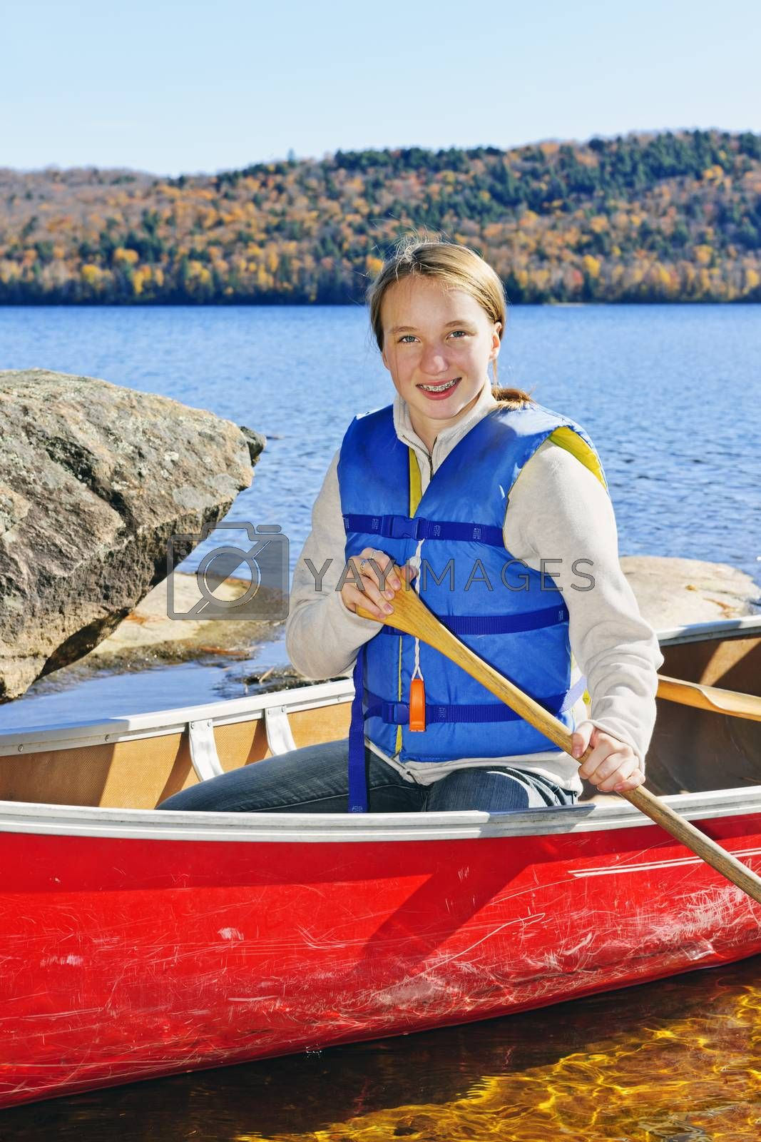 Teen girl canoeing on Lake of Two Rivers, Ontario, Canada