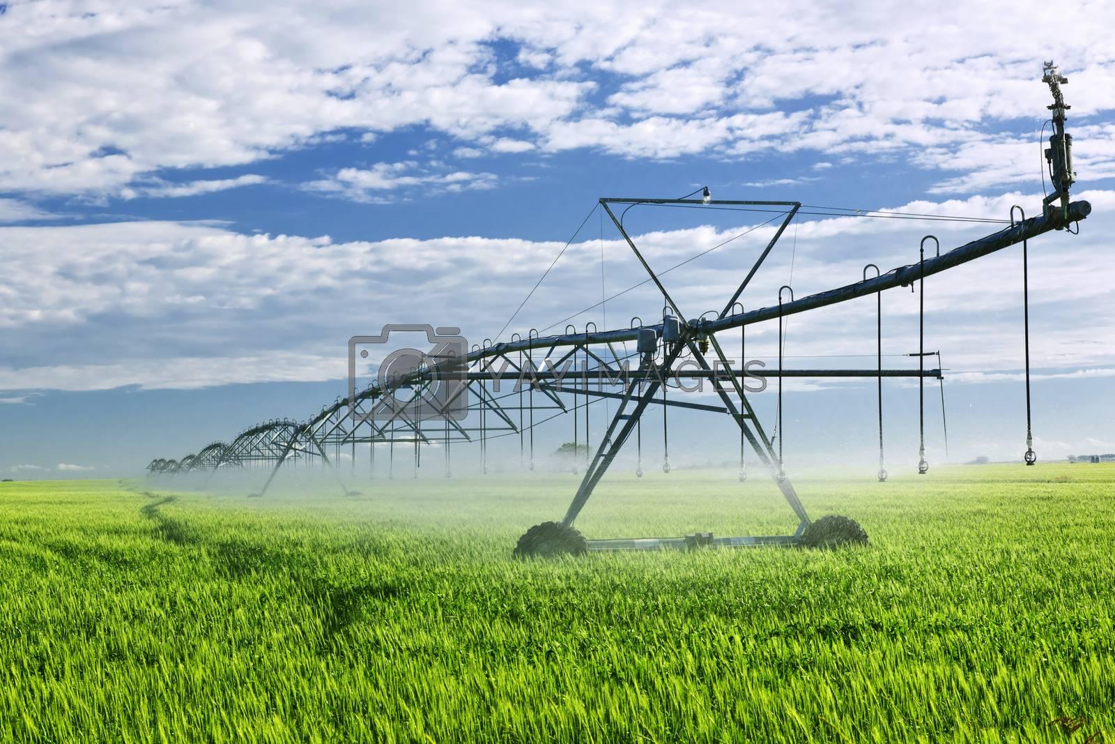 Industrial irrigation equipment on farm field in Saskatchewan, Canada