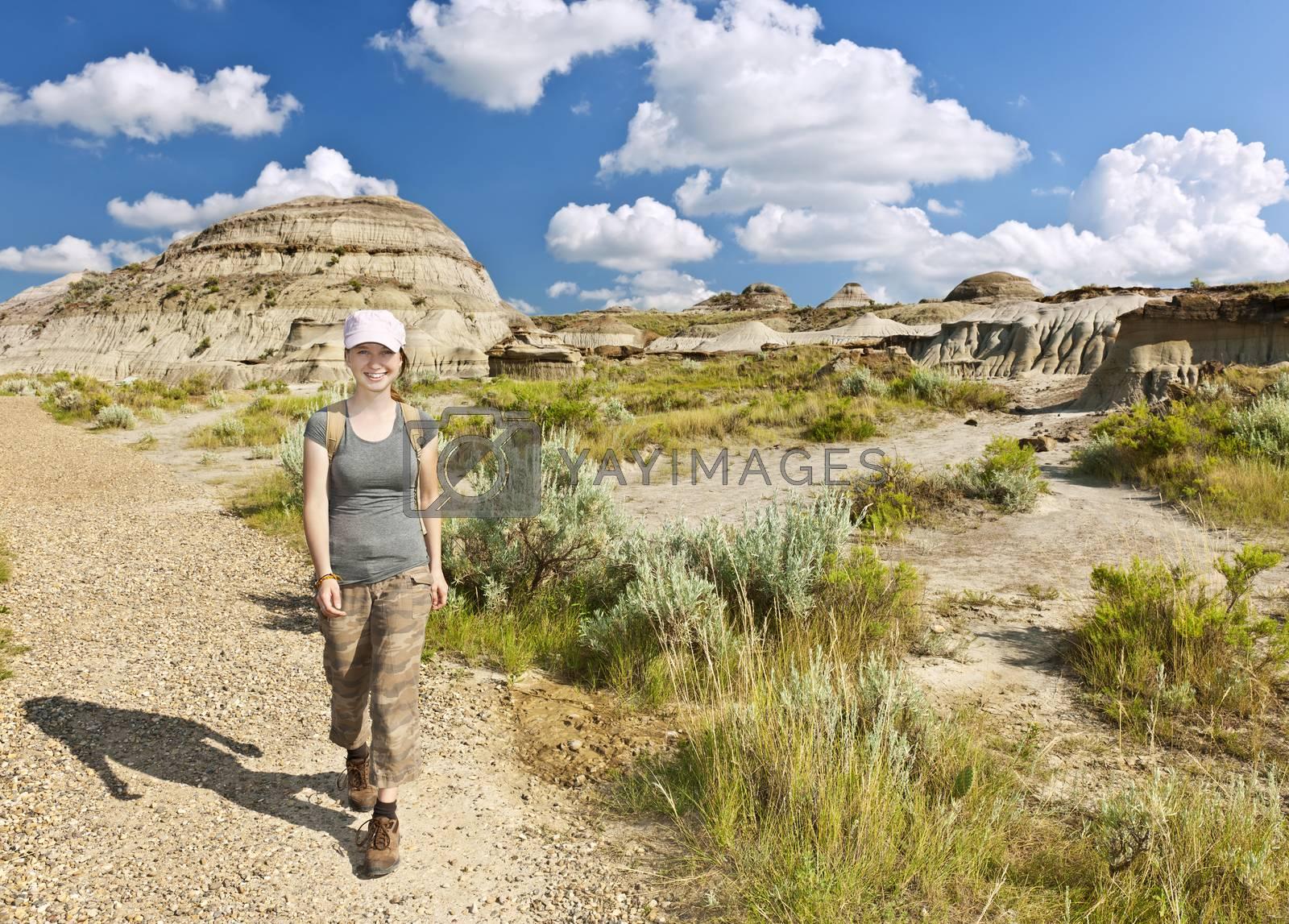 Happy girl hiking the Badlands in Dinosaur provincial park, Alberta, Canada