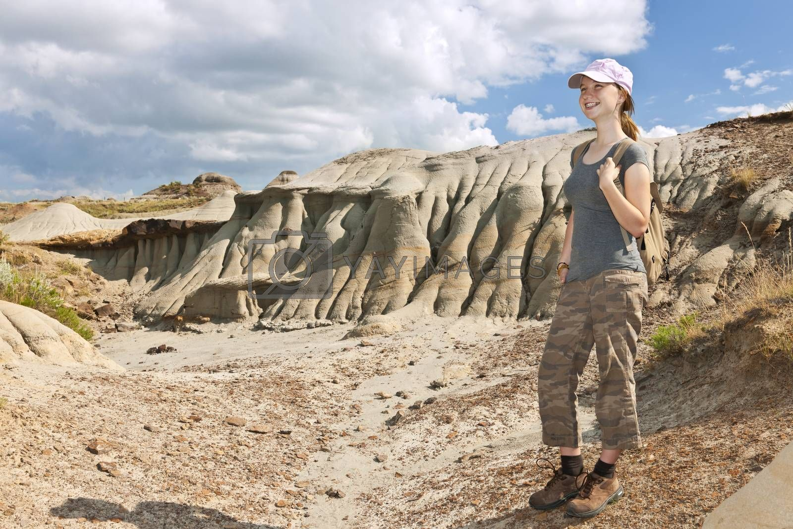 Smiling young girl standing at the Badlands in Dinosaur provincial park, Alberta, Canada