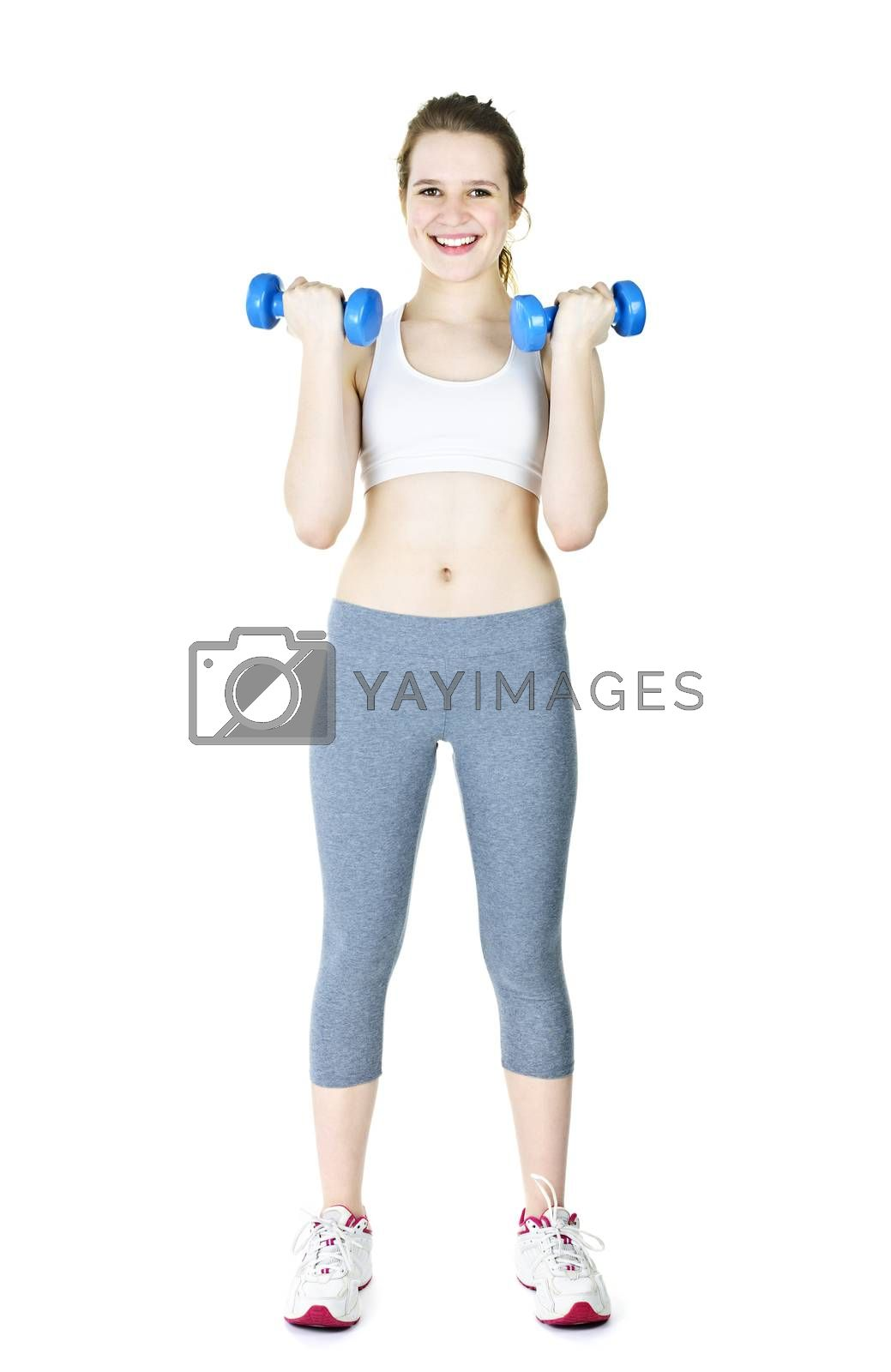 Happy fit young woman working out with weights standing on white background