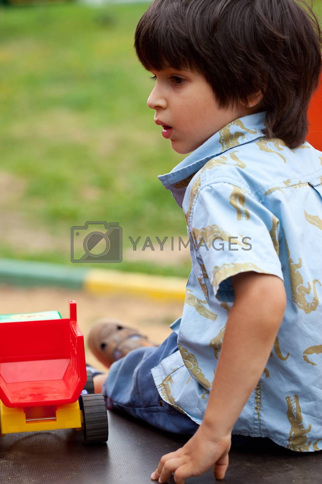 portrait of a young boy on the open air
