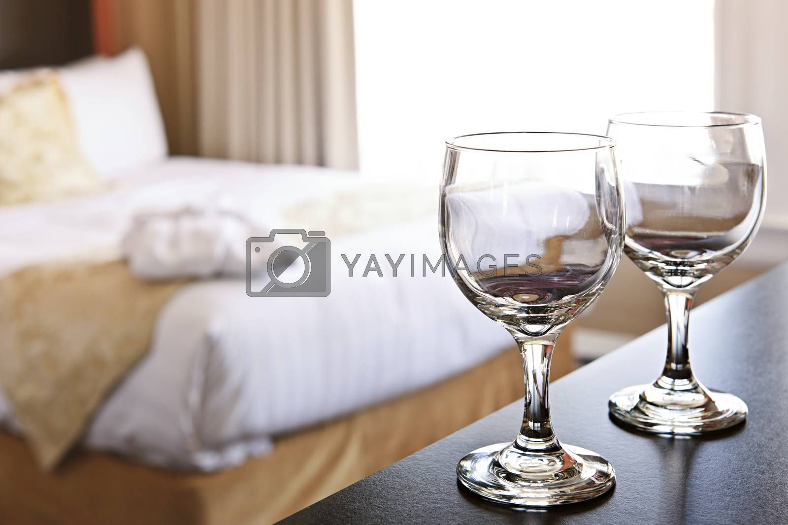 Romantic bedroom with wine glasses in luxury hotel interior