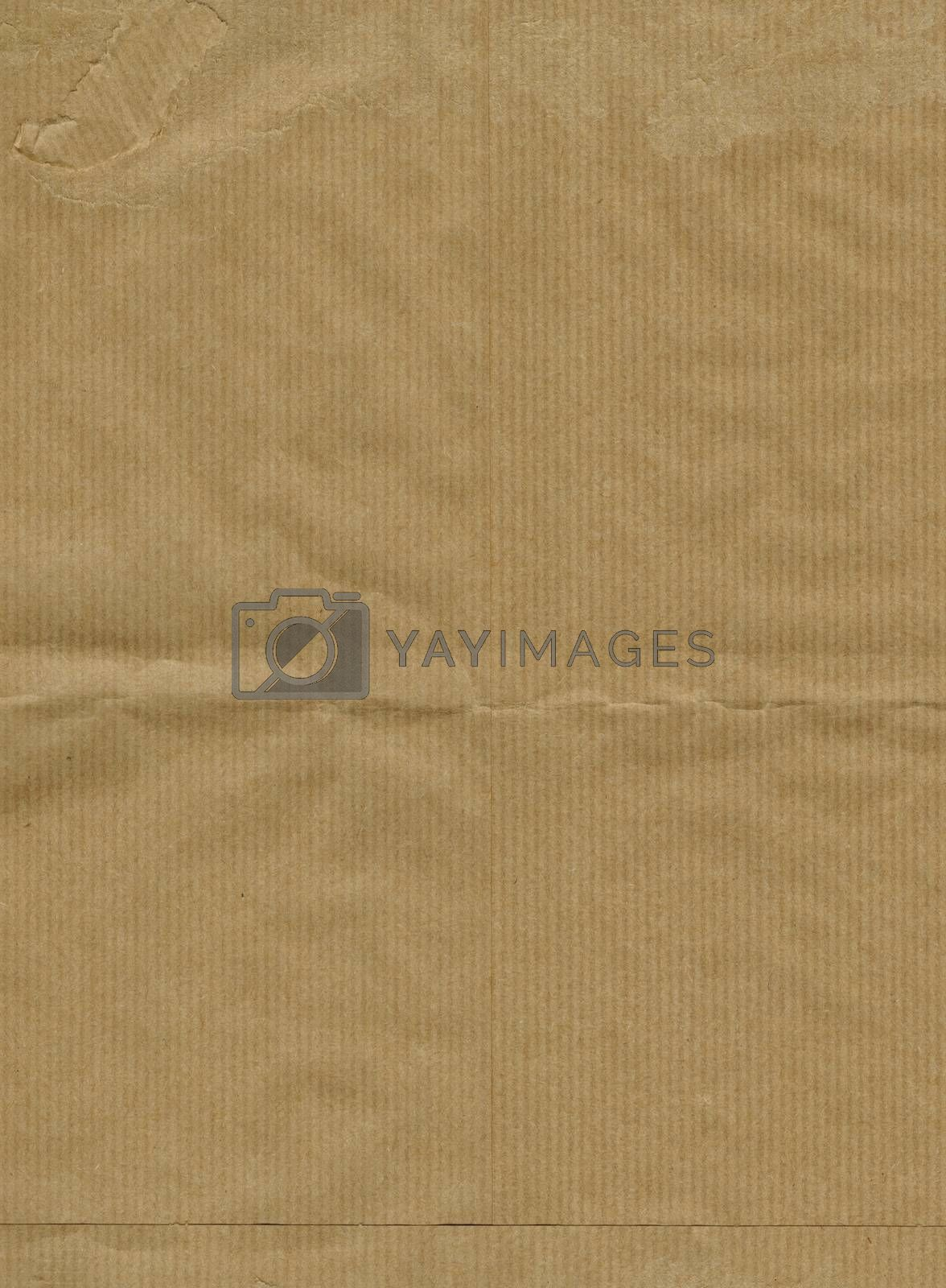 Brown corrugated cardboard sheet useful as a background
