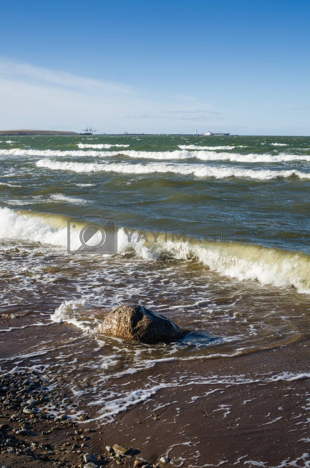 Sea waves lapping on the shore. Baltic Sea.