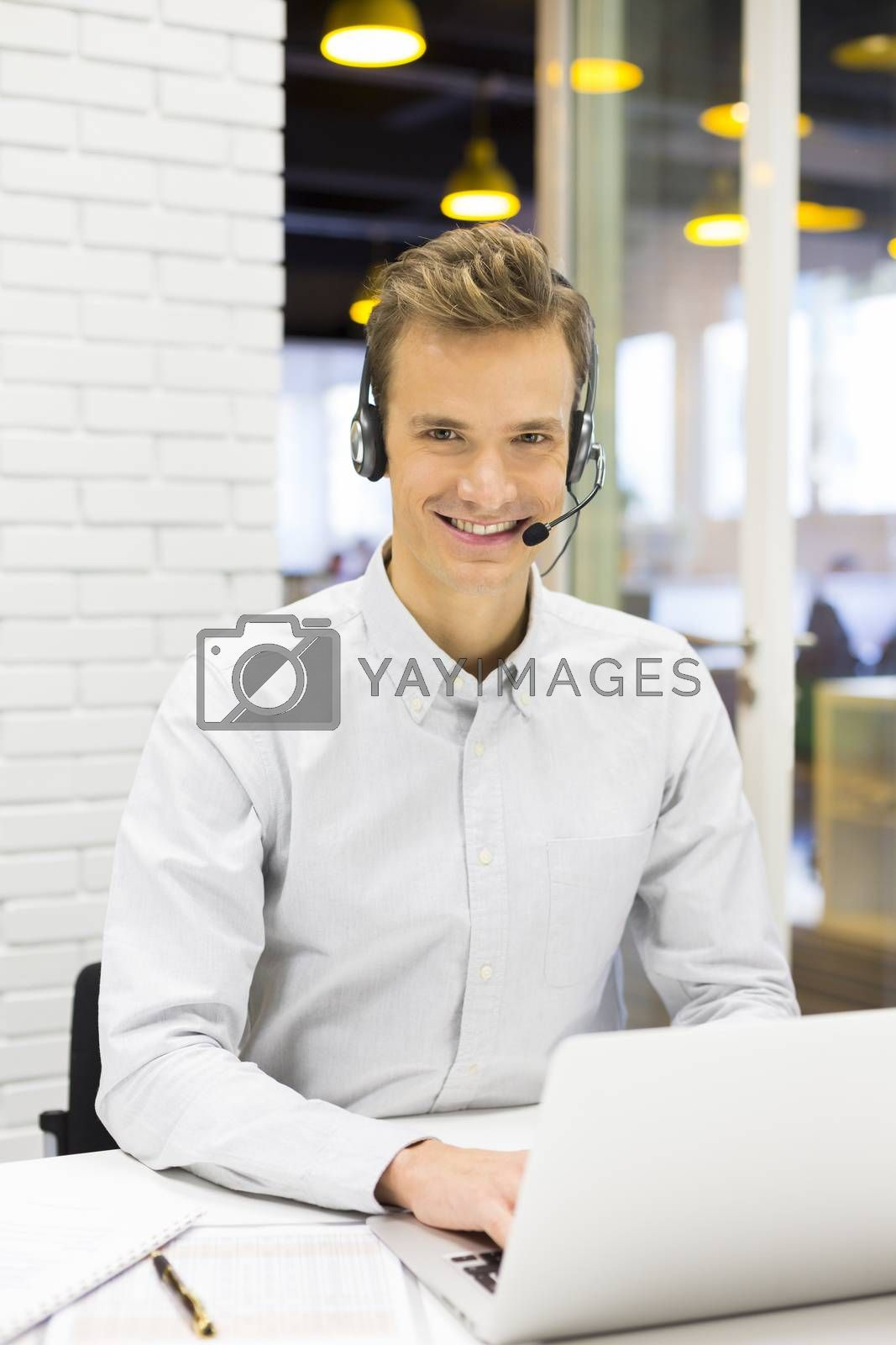 Male calling computer desk video conference looking camera
