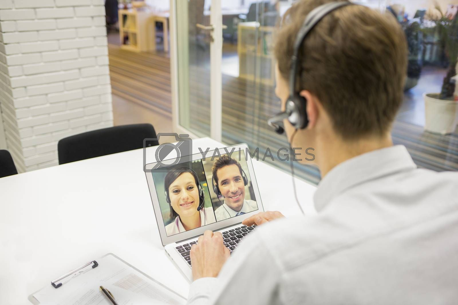 Male calling computer desk video phone