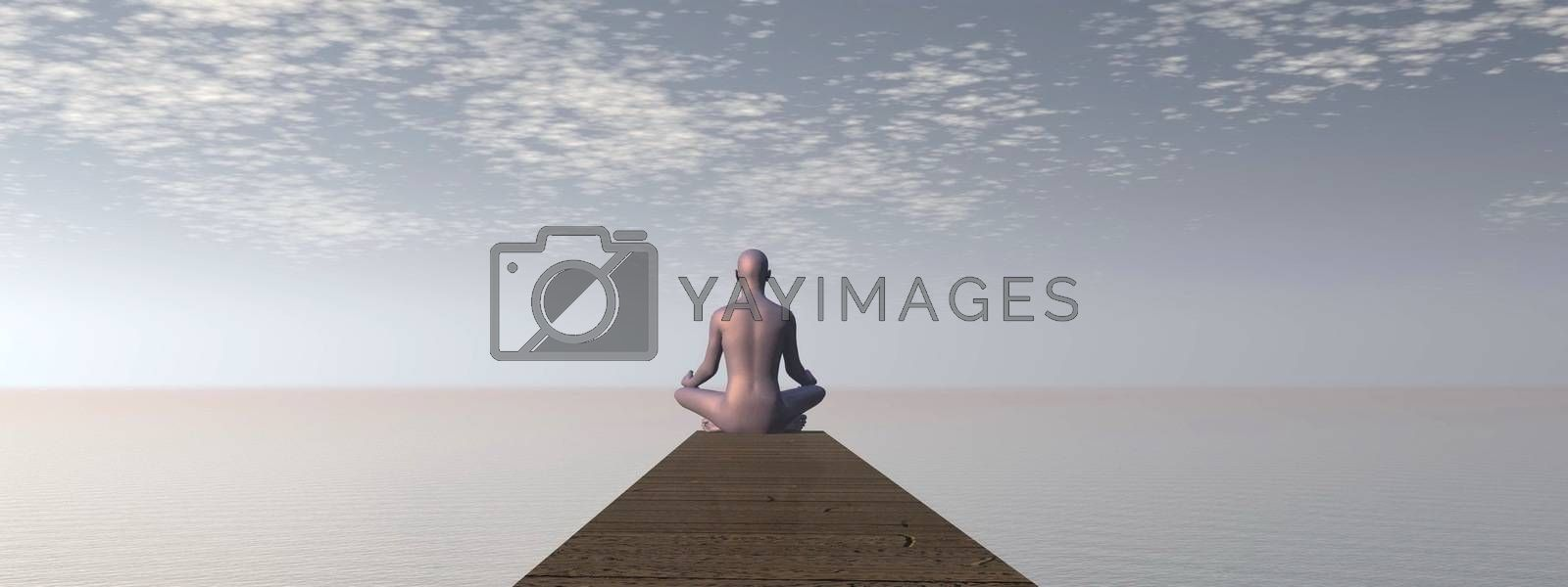 Man meditating on a pontoon in front of the ocean by morning light
