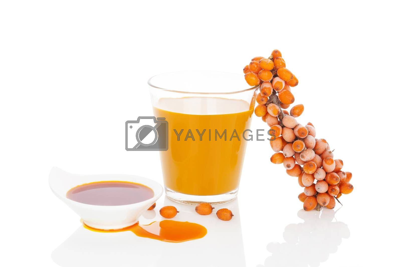 Sea buckthorn juice, oil and berries isolated on white background. Natural detox.