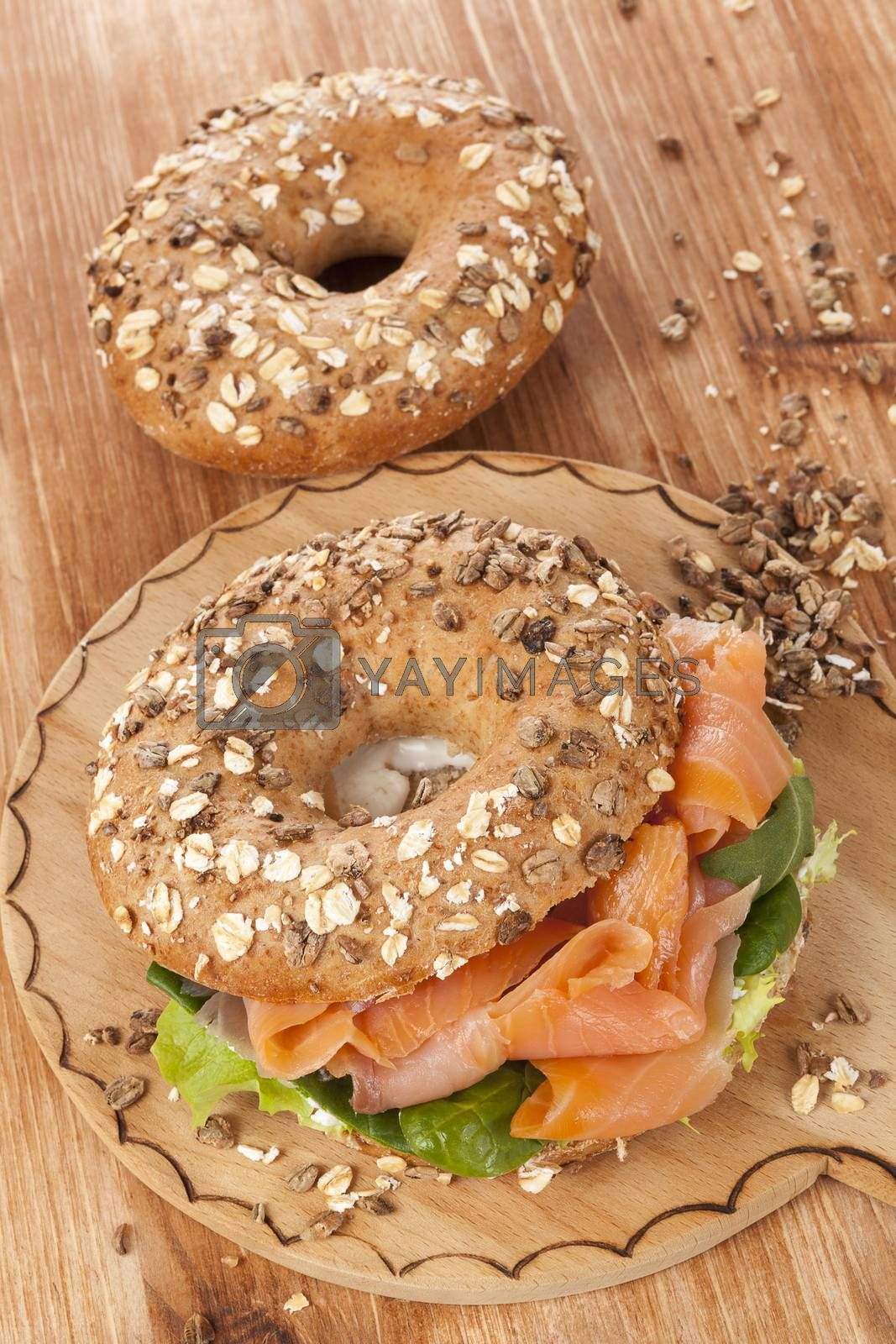 Delicious bagel with smoked salmon. Traditional amercan healthy eating.