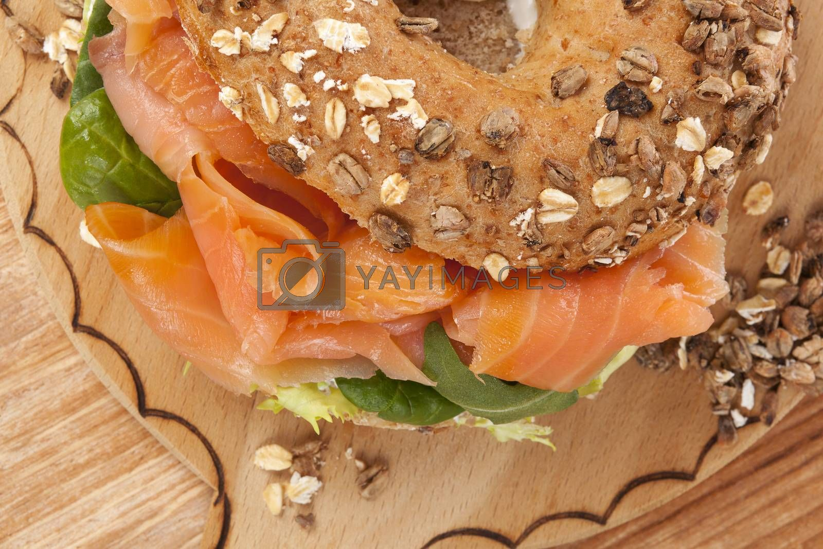 Delicious bagel eating. Fresh baked bagel with smoked salmon top view. American eating.