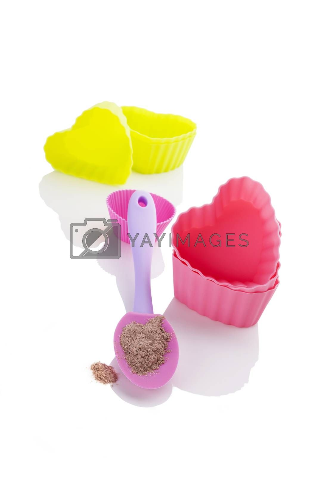 Contemporary baking forms with instant cookie mixture isolated on white background. Baking and cooking.