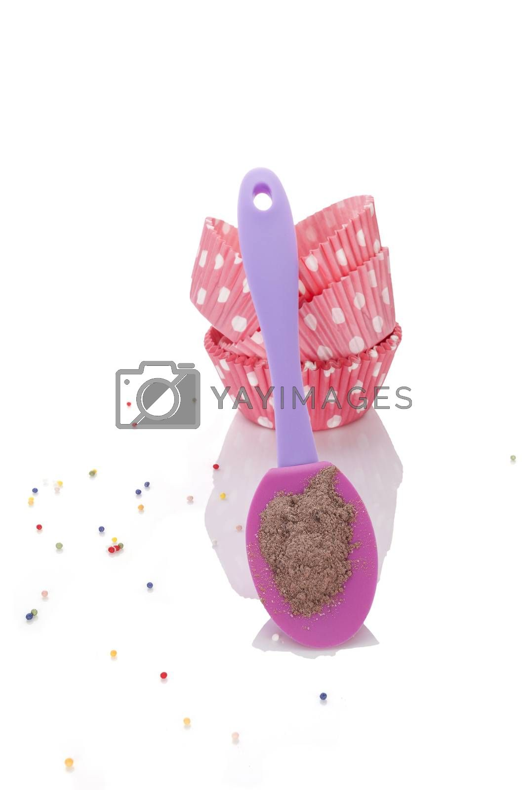 Baking cookies. Chocolate cookie mixture, baking forms and sweet garnish isolated on white background.