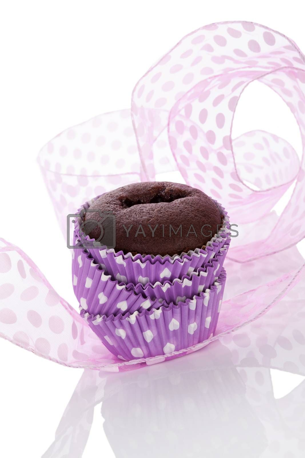 Chocolate cupcake in purple and white. Contemporary modern baking.