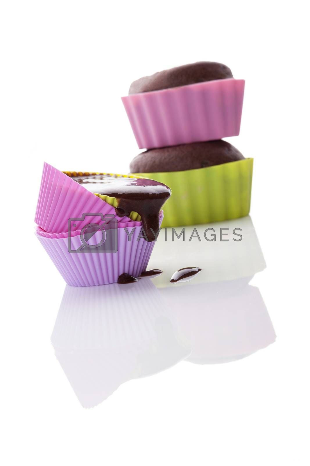 Cupcake mixture dropping from baking form isolated on white background. Making cupcakes.