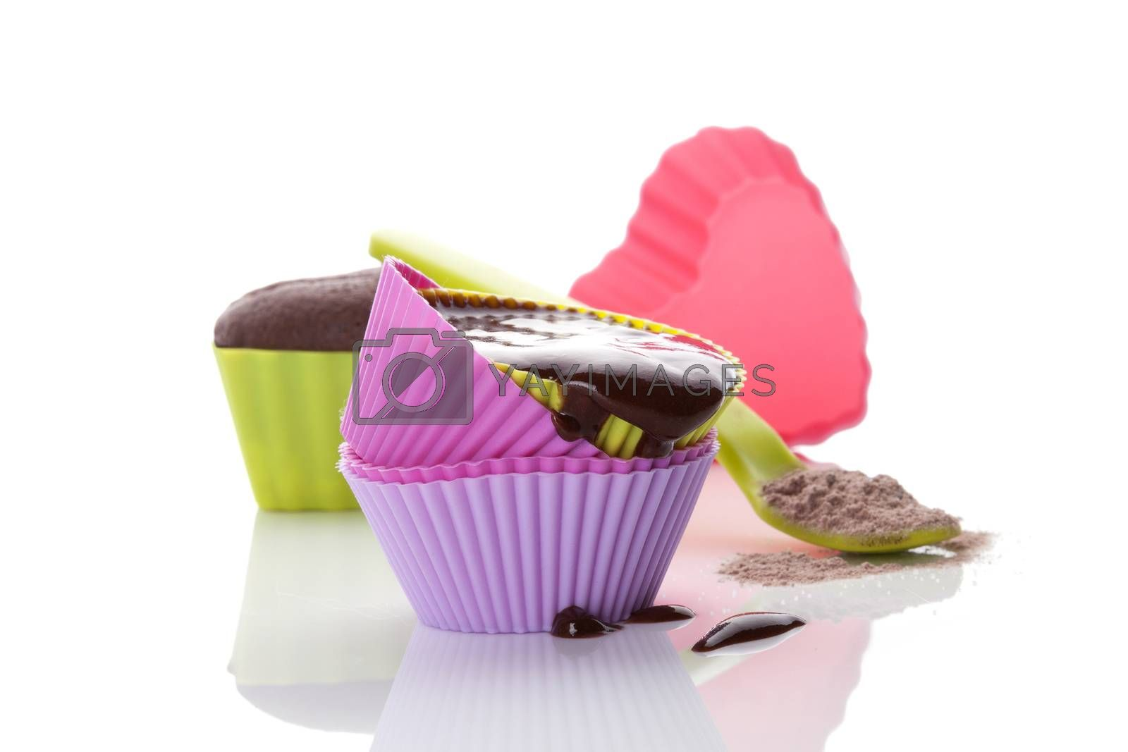 Cupcake chocolate mixture in neon colored baking forms isolated on white background. Culinary cupcakes baking.