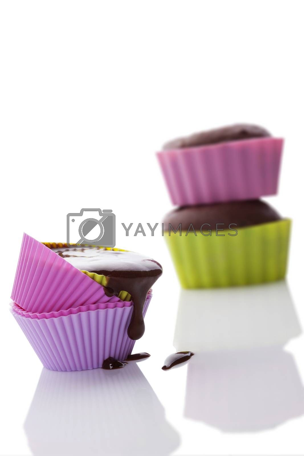Making cupcakes. Cupcake mixture in neon colored silicone baking forms isolated on white background.