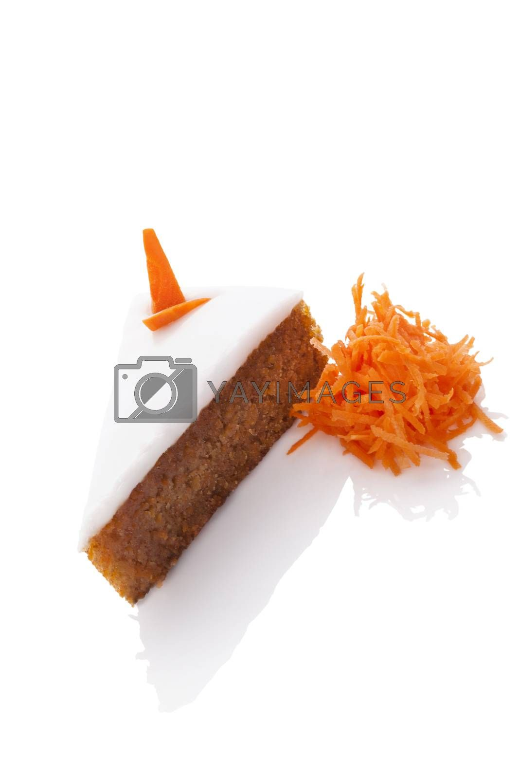 Delicious carrot cake on grated carrots isolated on white background. Culinary sweet dessert.