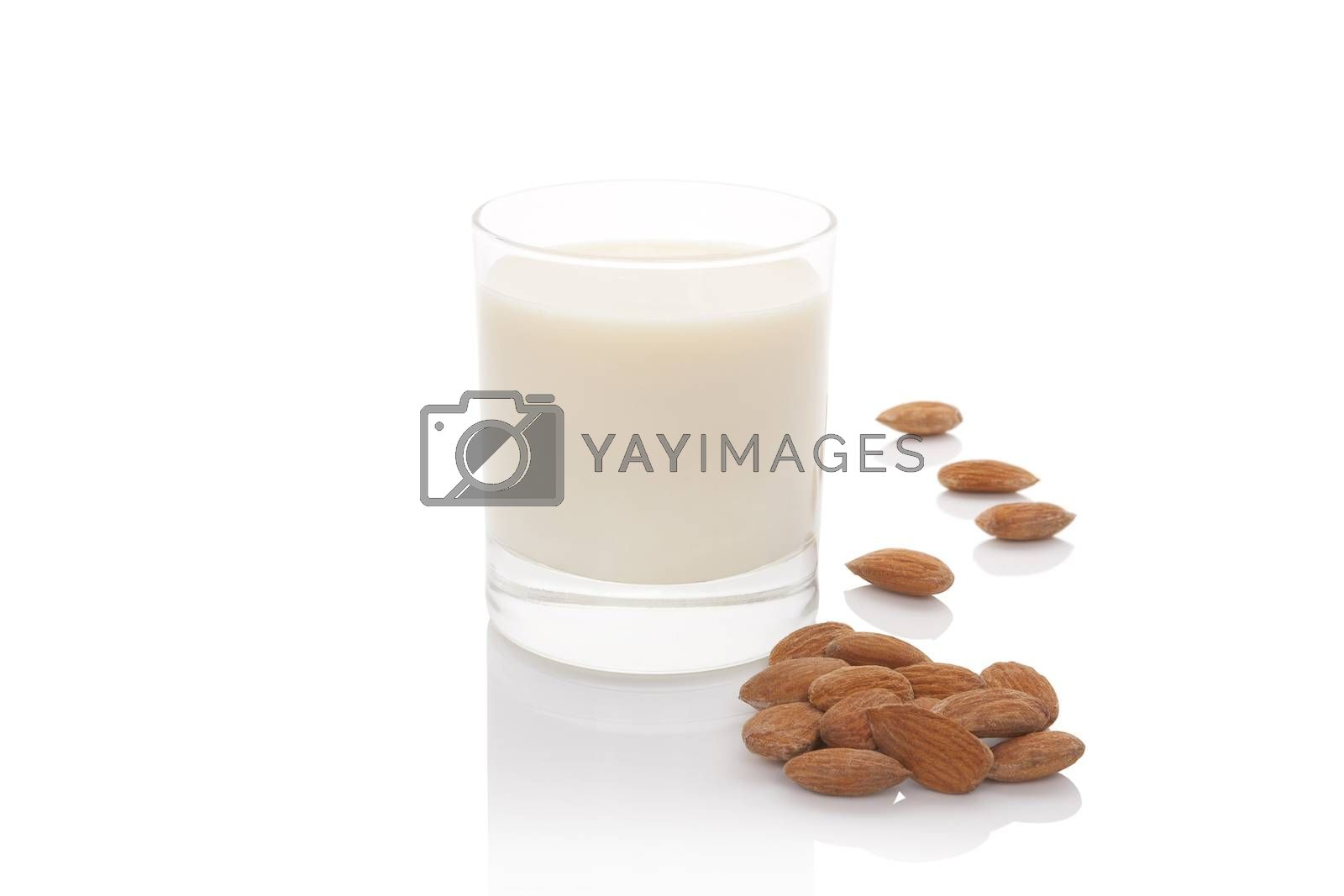 Almond milk in glass with almond nuts isolated on white background. Vegan and vegetarian milk concept.