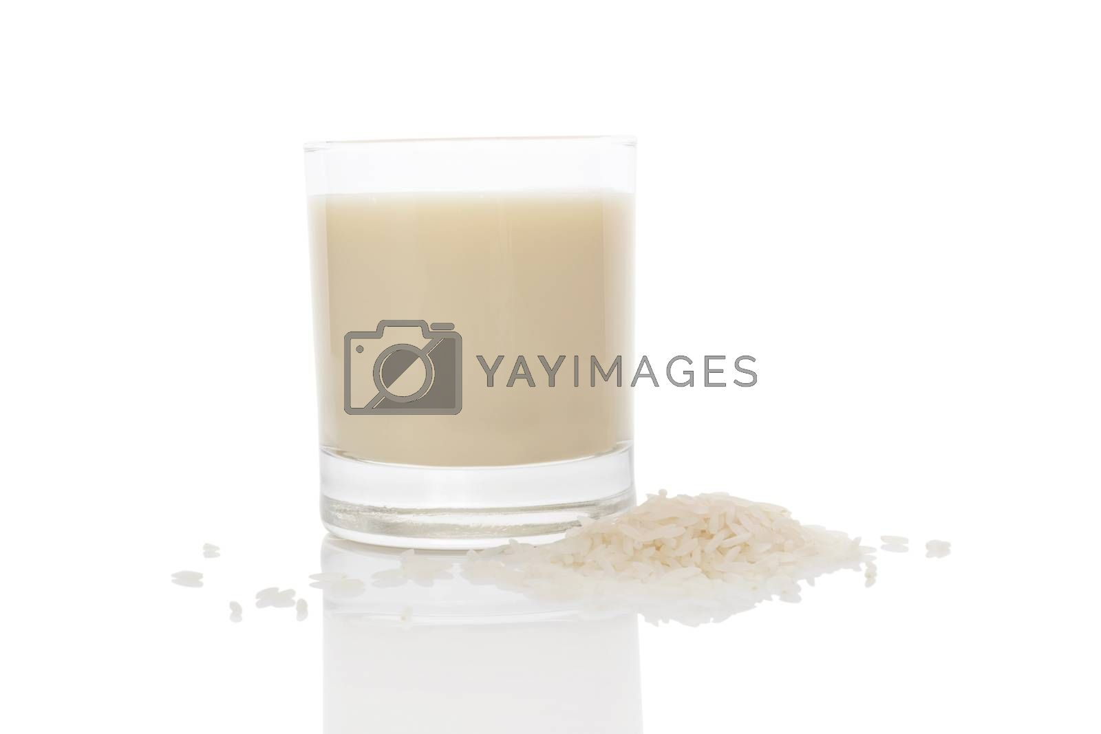 Rice milk in glass isolated on white background. Vegan and vegetarian milk concept.