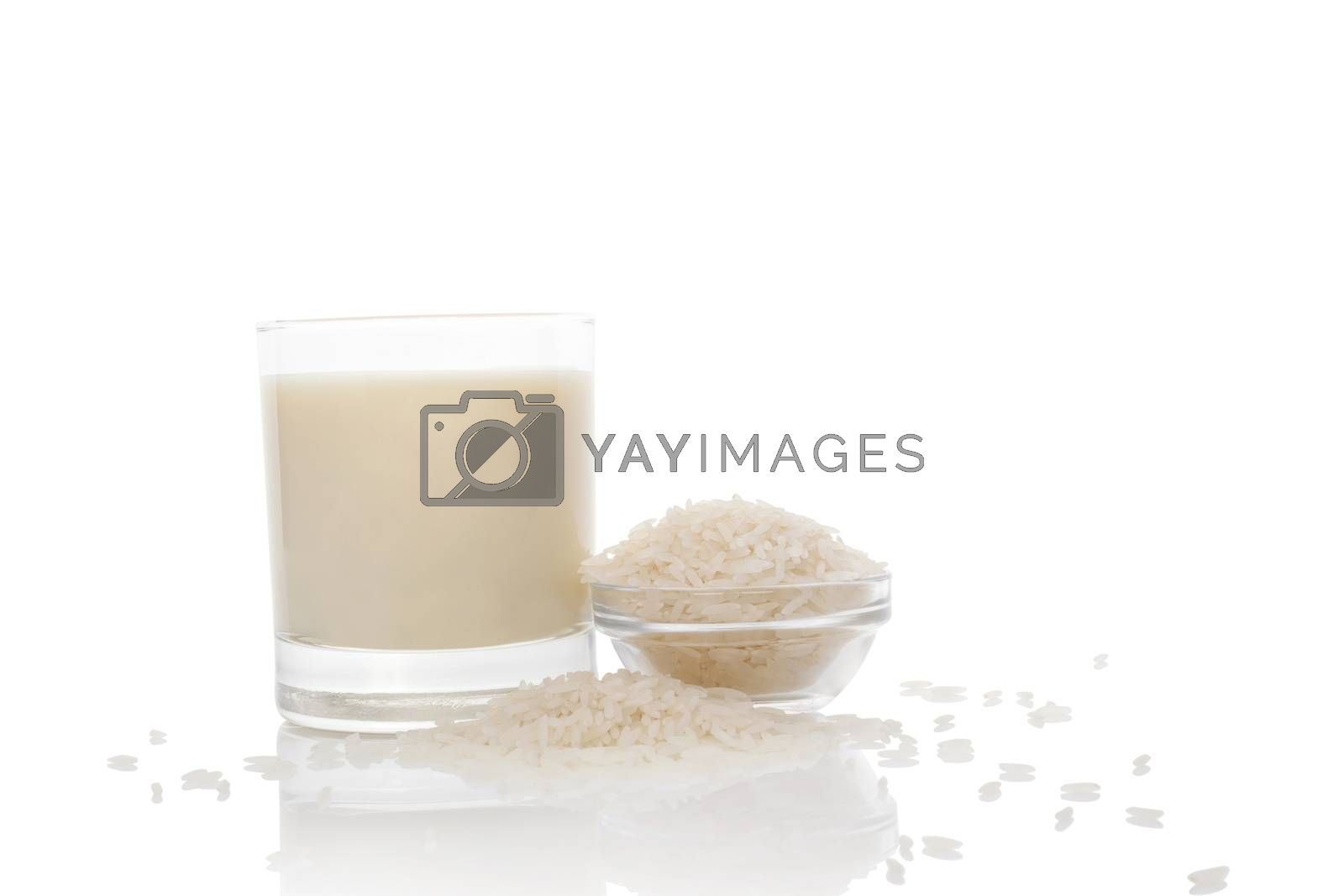 Rice milk in glass and rice crop  isolated on white background. Vegan and vegetarian milk concept.