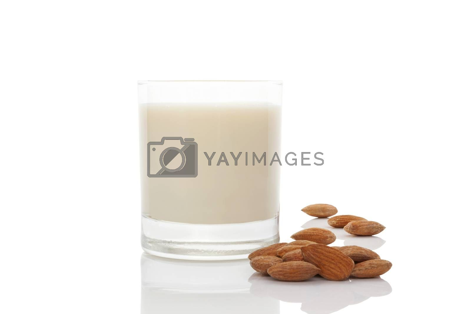 Almond milk in glass with almond nuts  isolated on white. Vegan and vegetarian eating.