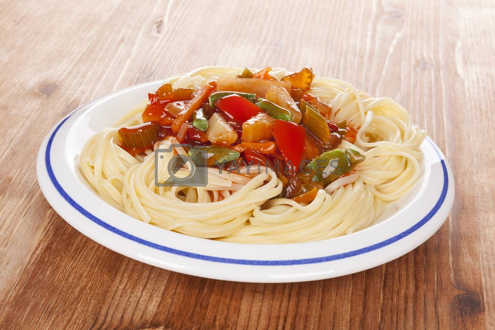 Delicious thai vegetarian pasta on white plate on wooden background. Healthy vegetarian eating.