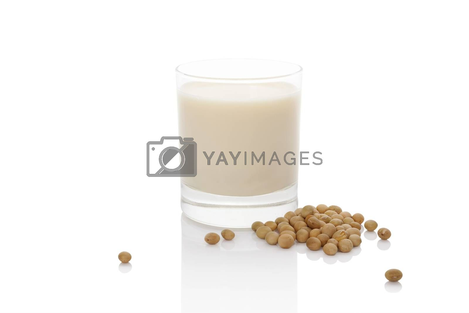 Soy milk in glass with soya beans isolated on white. Vegan milk concept.