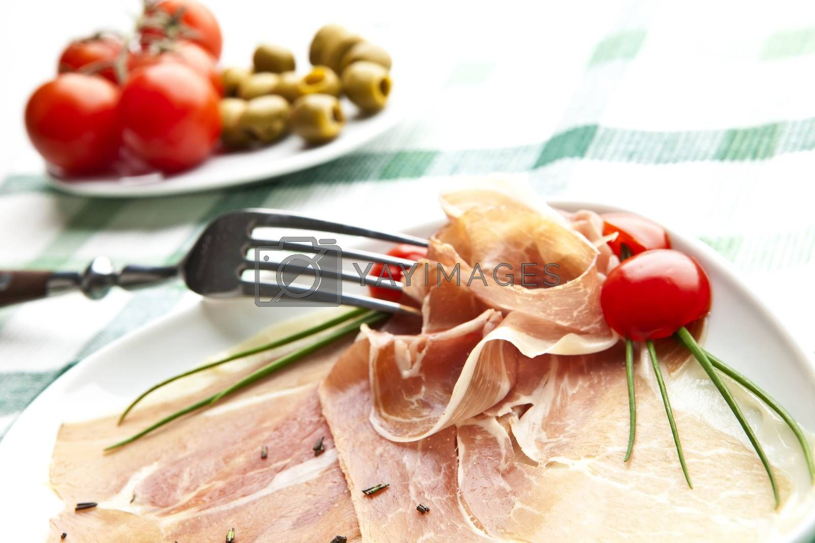 delicious Prosciutto plate with olives, tomatos.