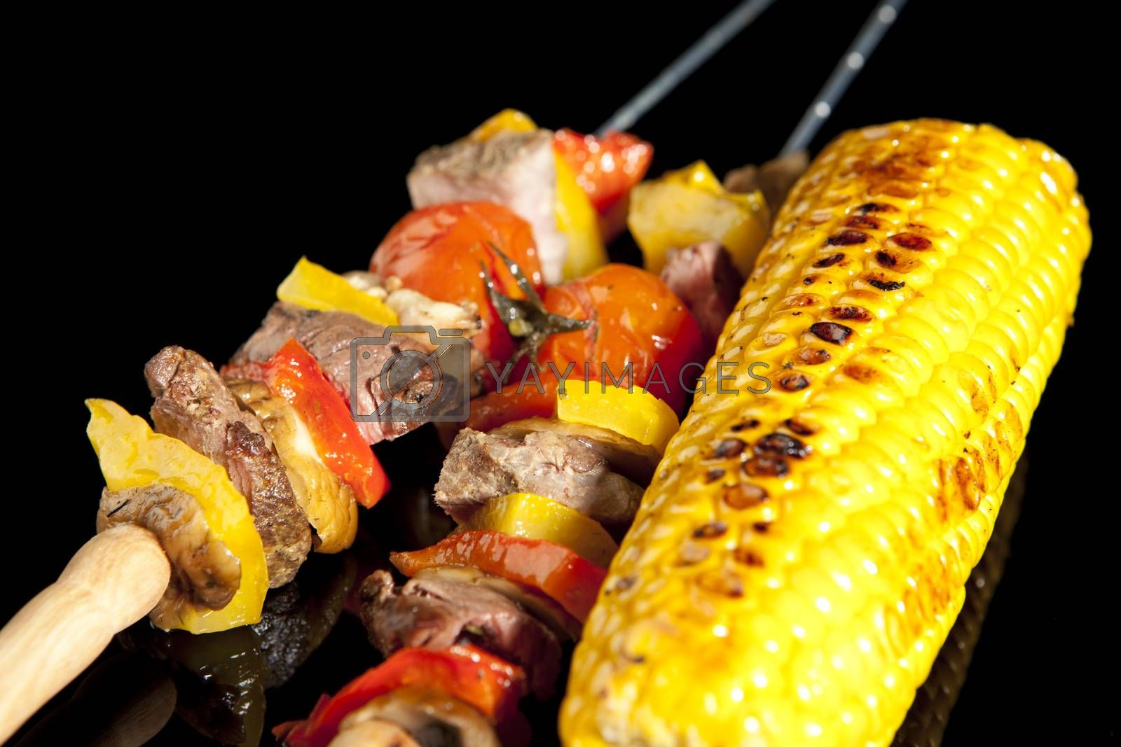 Barbeque sticks with meat, vegetables and corn