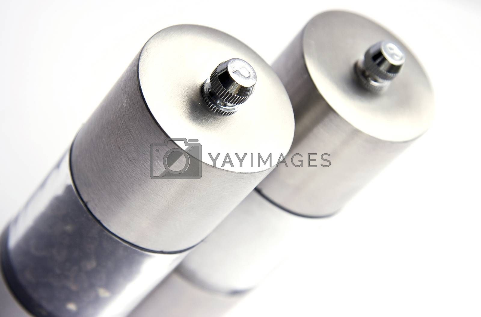 Salt and pepper mills on white background