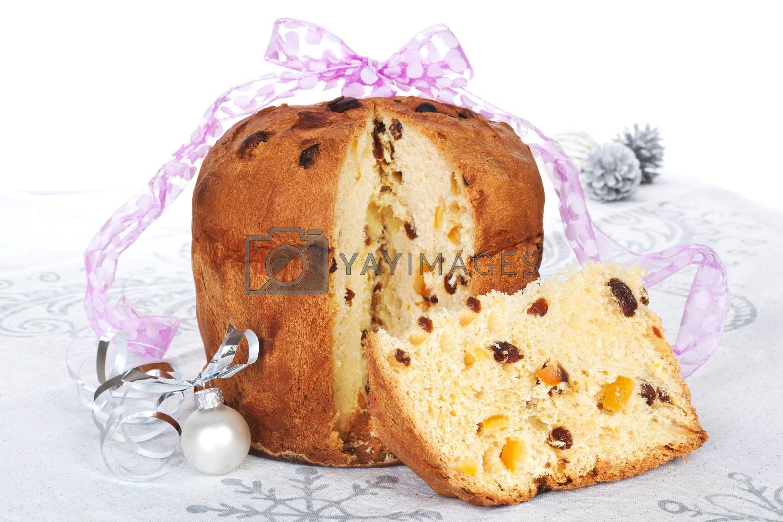 Panettone fruit cake with christmas decoration and ribbon. Festive xmas background.