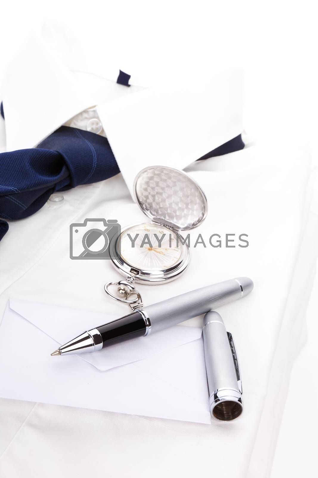 Luxurious business still life with white dress shirt, blue tie, pen, envelope and silver pocket watch. Business concept.