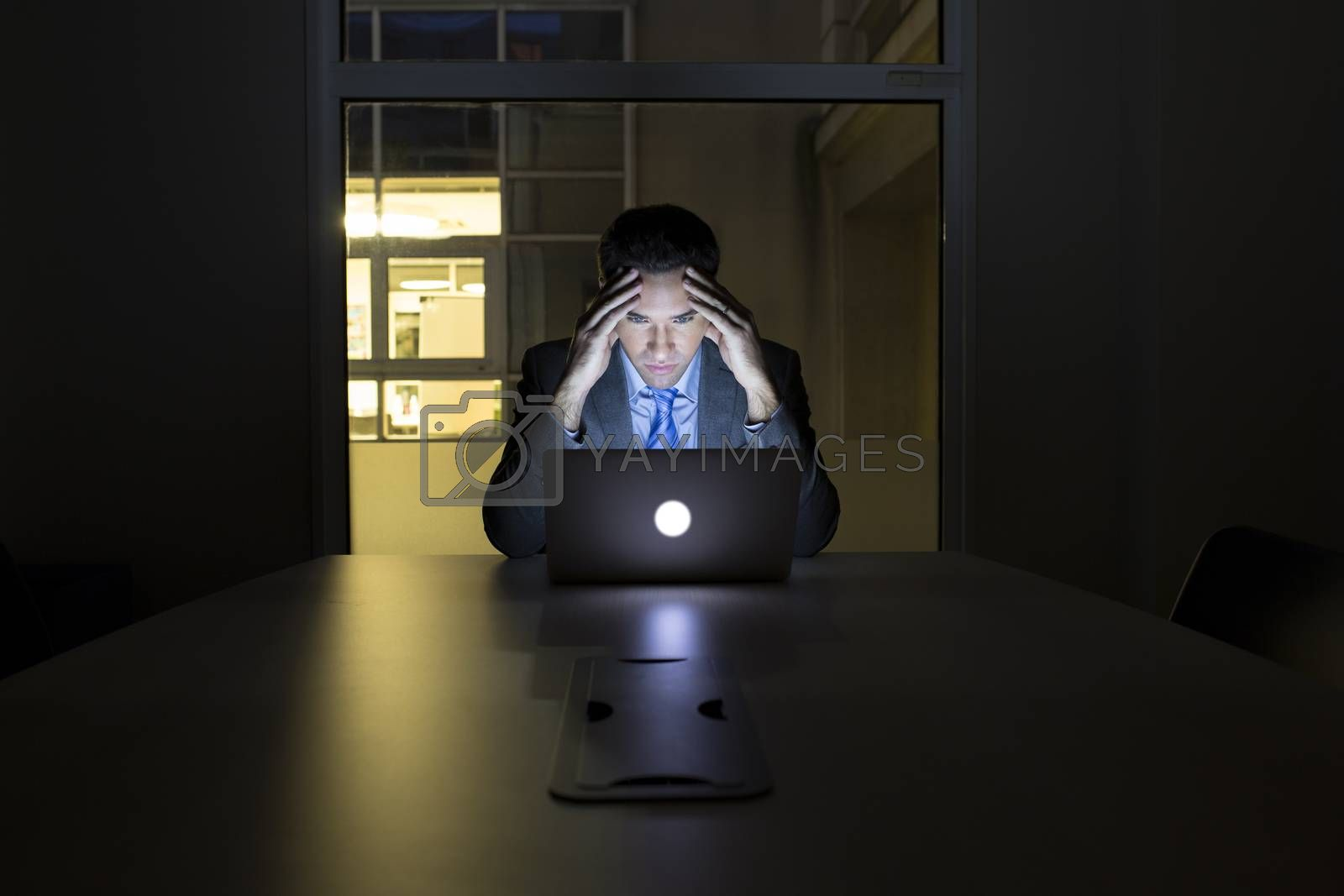 Male business computer desk evening tired busy