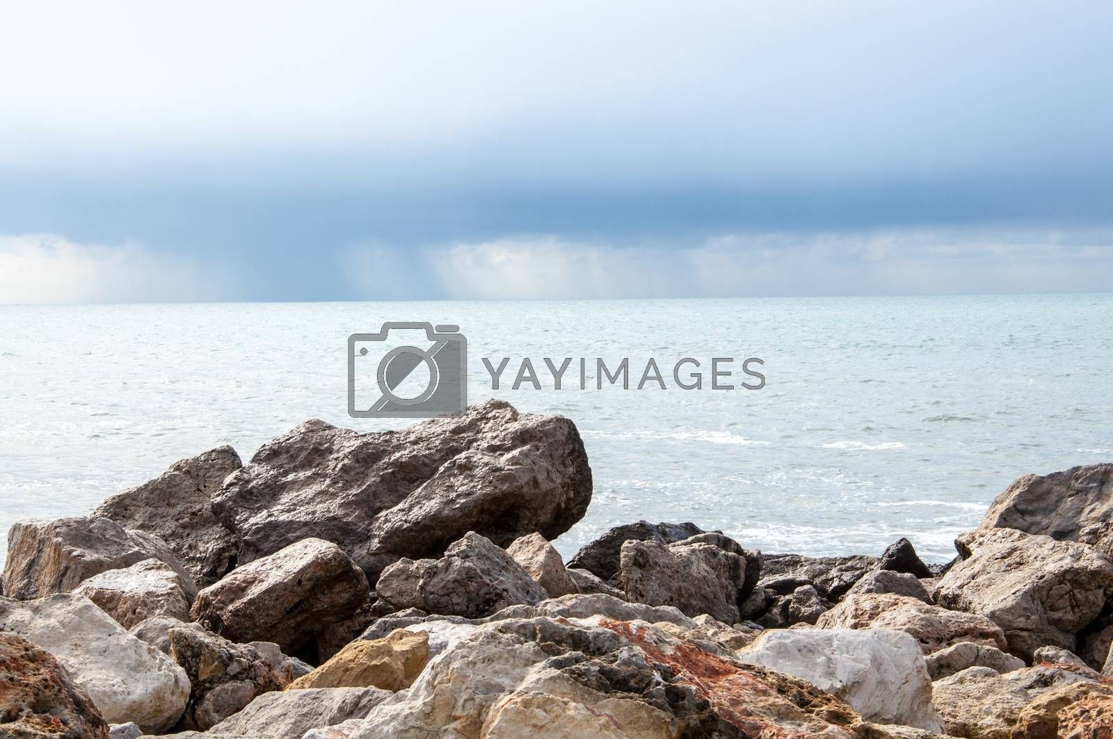 Rocks, ocean and rain. by Artesia Wells