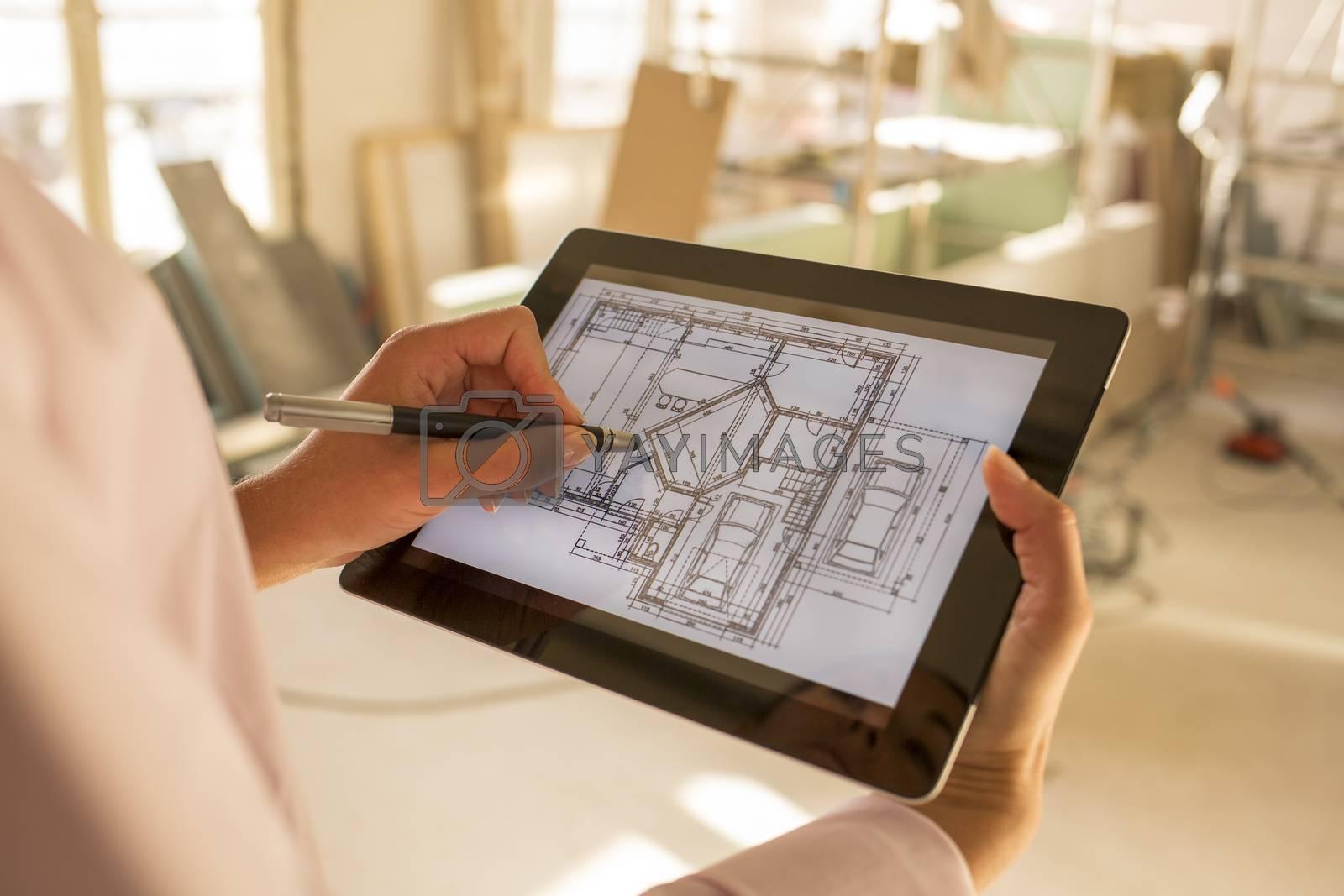 Female hand close-up computer work blueprint inside Stylus