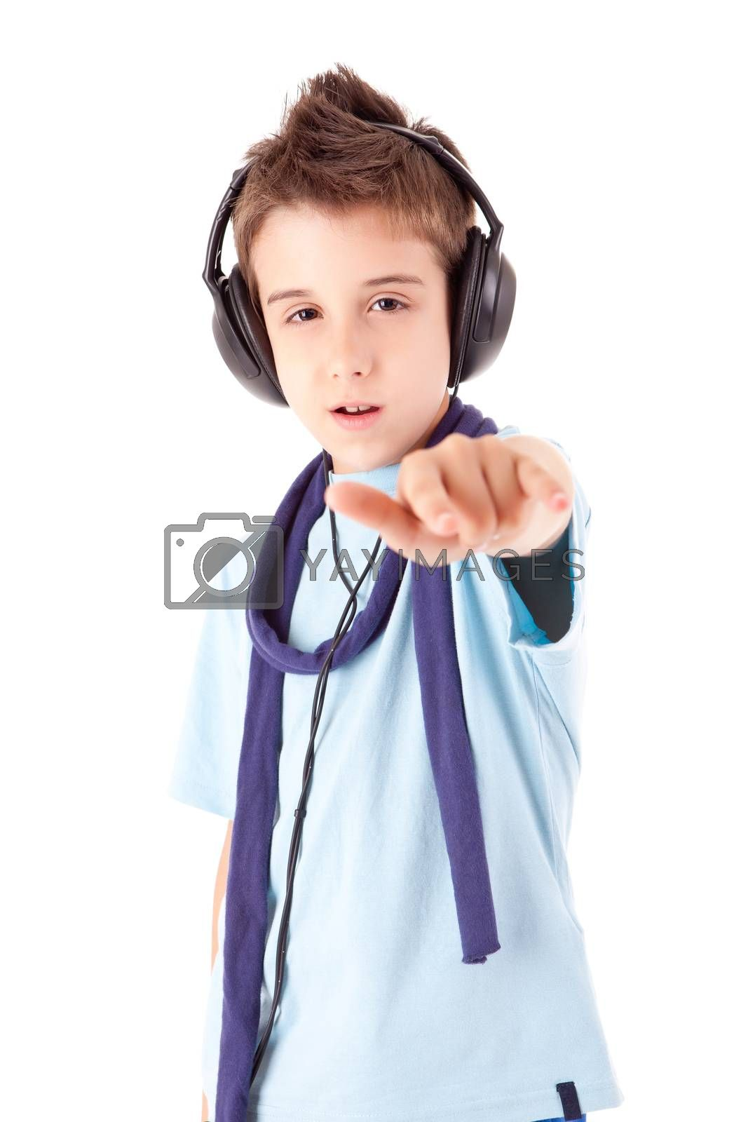 Cute little boy enjoying music using headphones by jolopes
