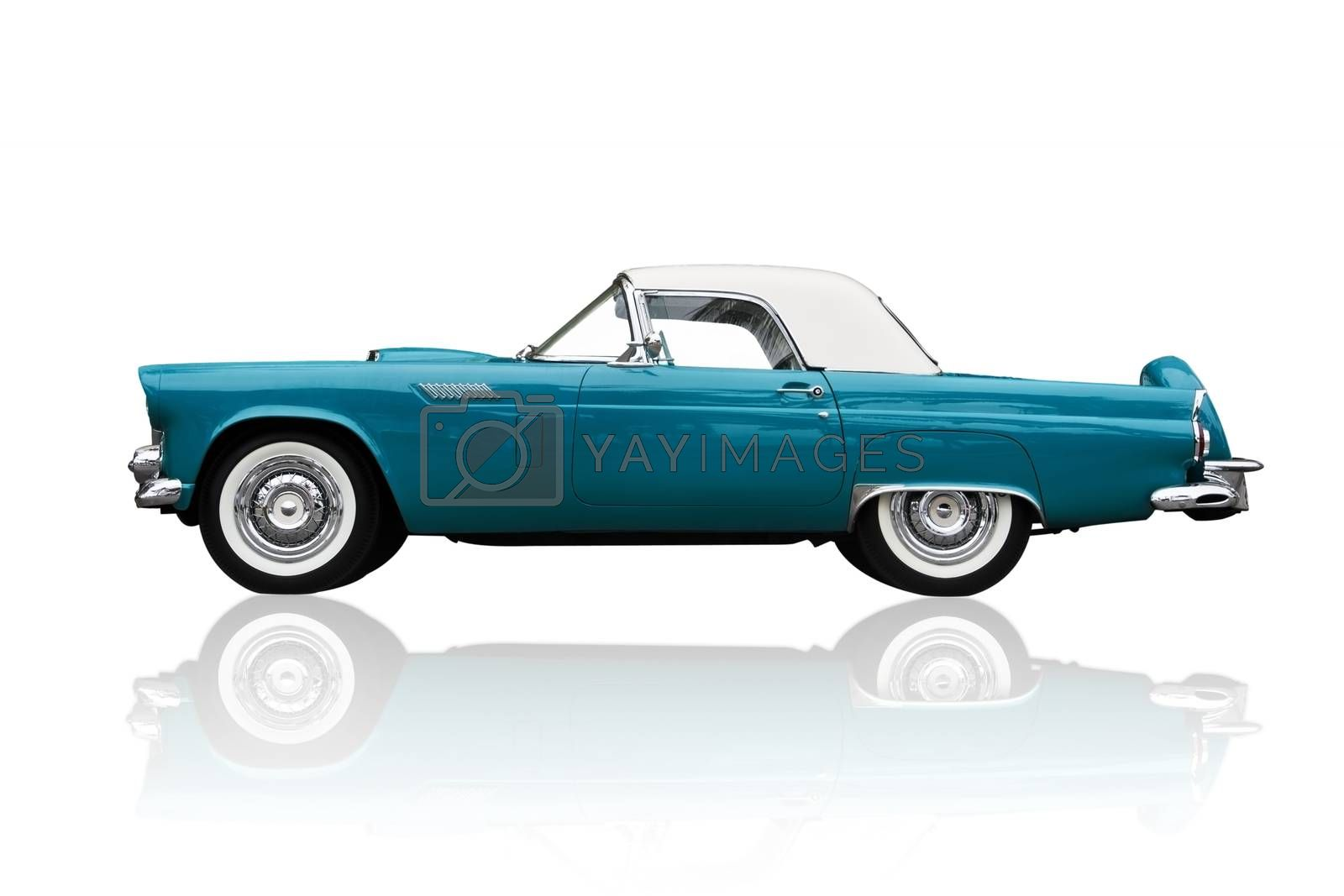 Shiny metallic old american retro car isolated on white with clipping path. Ford Thunerdbird.