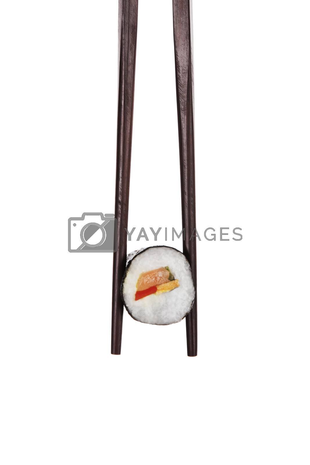 Sushi. Holding maki sushi with chopsticks. by eskymaks