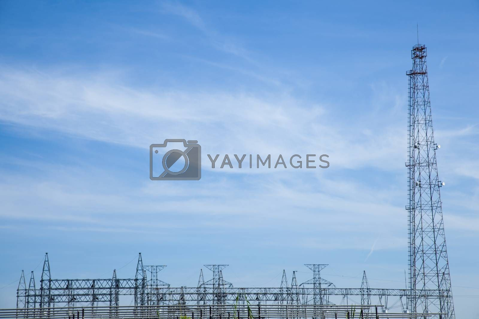 High voltage towers. The meadow below. Industry and nature coexist in appropriate Slightly cloudy sky.And sailed through the air.